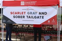 Tailgate--Scarlet Gray and Sober tailgate banner over a food table