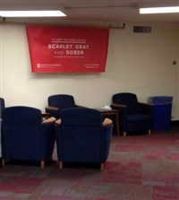 Collegiate Recovery Community room in Lincoln Tower with chairs and Scarlet, Gray and Sober banner