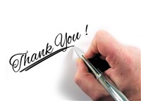 Thank you written in script by hand with fountain pen