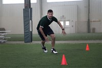 Rec Sports Cone drill with athlete running around cone