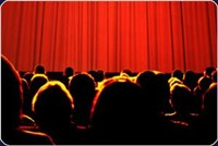 Showtime with a crowd seating waiting in front of a closed curtain