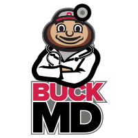 Buck MD with Brutus in doctor's white coat and stethoscope